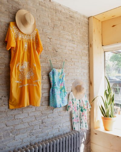 summer-outfits-displayed-on-exposed-wall-in-store